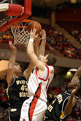08 January 06  Michael Vandello attacks the basket but gets blocked by Paul Miller...The Illinois State Redbirds come up short against the Witchita State Shockers.  The Shockers put on a 2nd half show that left the Redbirds trailing 56 - 47 at the bell.  Dana Ford of the Redbirds matched his career high with 16 points, adding 7 boards and 4 steals...Redbird Arena, Illinois State University  campus, Normal, Illinois...