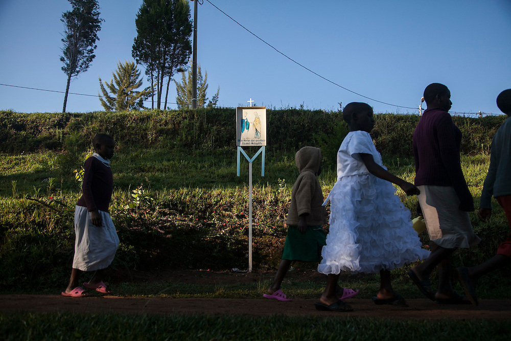 People walk along an outdoor rosary path on their way to the Shrine of Our Lady of Sorrows in Kibeho, Rwand. This, is the only sanctioned Marian sanctuary in Africa. Kibeho's overseers and the Rwandan government hope this place will become a top tourism site. The Virgin Mary appeared here in 1981to three young women.<br /> <br /> Photographed on Sunday, October 26, 2014.<br /> <br /> Photo by Laura Elizabeth Pohl
