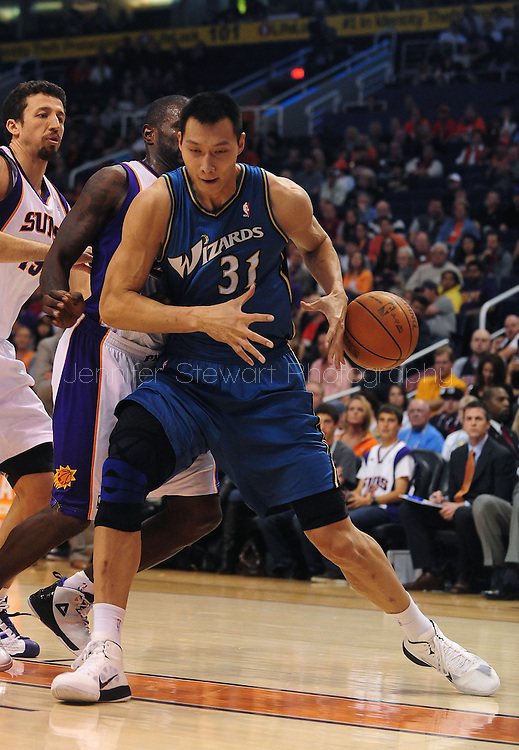 Dec. 5 2010; Phoenix, AZ, USA; Washington Wizards forward Yi Jianlian (31) loses the ball during the first half against the Phoenix Suns at the US Airways Center. The Suns defeated the Wizards 125-108. Mandatory Credit: Jennifer Stewart-US PRESSWIRE.