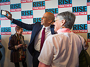 05 DECEMBER 2019 - DES MOINES, IOWA: US Senator CORY BOOKER (D-NJ) does selfies with voters at his rally after he finished his formal speech in Des Moines Friday. He talked about the need to reunify the country. Senator Booker is running to be the Democratic nominee for the US Presidency in 2020. Iowa hosts the first selection event of the presidential election season. The Iowa caucuses are February 3, 2020.          PHOTO BY JACK KURTZ
