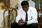 Karsiah Duncan, the son of Ebola patient Thomas Eric Duncan, sits down during a press conference at at Wilshire Baptist Church on October 7, 2014, in Dallas. (Cooper Neill for The New York Times)