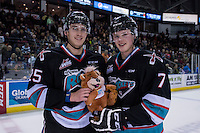 KELOWNA, CANADA - DECEMBER 5: Cal Foote #25 and Lucas Johansen #7 of Kelowna Rockets pose with a teddy bear on the ice after the annual teddy bear toss against the Portland Winterhawks  on December 5, 2015 at Prospera Place in Kelowna, British Columbia, Canada.  (Photo by Marissa Baecker/Shoot the Breeze)  *** Local Caption *** Cal Foote; Lucas Johansen;