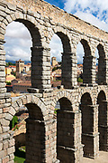 Famous spectacular Roman aqueduct, built of granite blocks, by Plaza del Azoguejo, Segovia, Spain