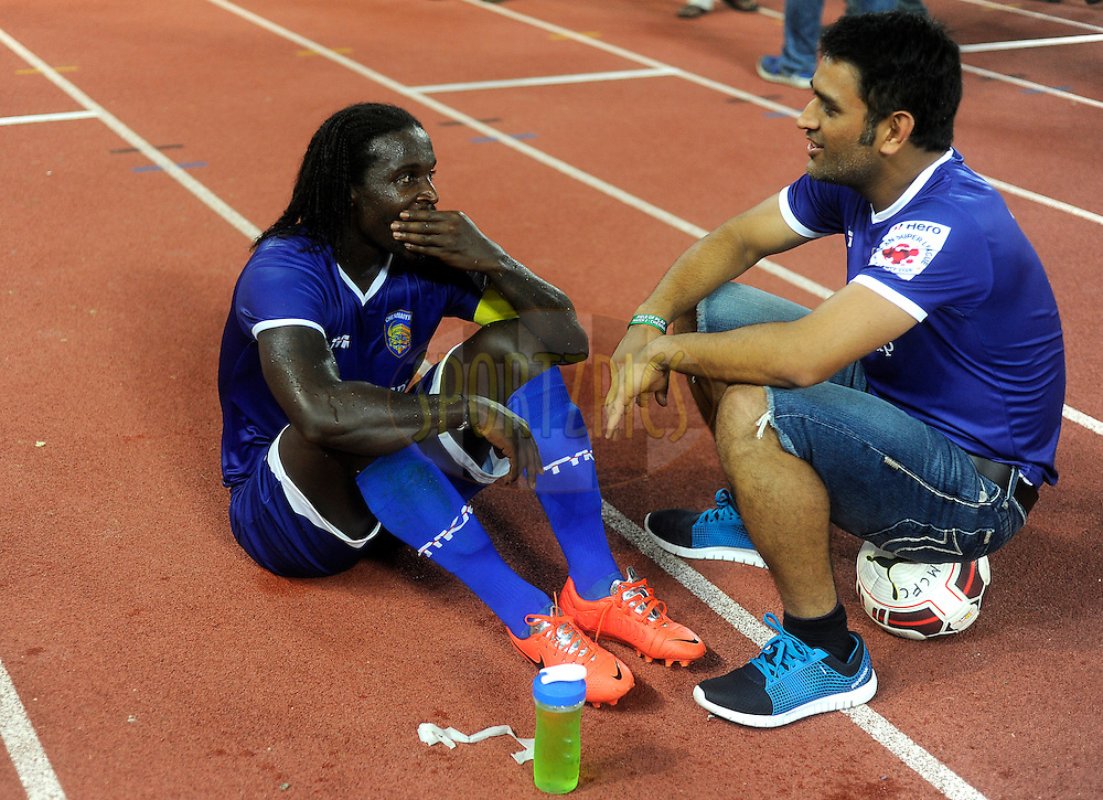 Bernard Mendy of Chennaiyin FC Mahendra Singh Dhoni co-owner of Chennaiyin FC and Indian Cricket captain have a chat after winning match 15 of the Hero Indian Super League between Chennaiyin FC and Mumbai City FC held at the Jawaharlal Nehru Stadium, Chennai, India on the 28th October 2014.<br /> <br /> Photo by:  Pal Pillai/ ISL/ SPORTZPICS