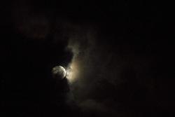 November 14, 2016 - Denpasar, Bali, Indonesia - Supermoon seen enclosed with a black cloud raining on november 14, 2016 in Denpasar, Bali, Indonesia. (Credit Image: © Muhammad Fauzy/NurPhoto via ZUMA Press)