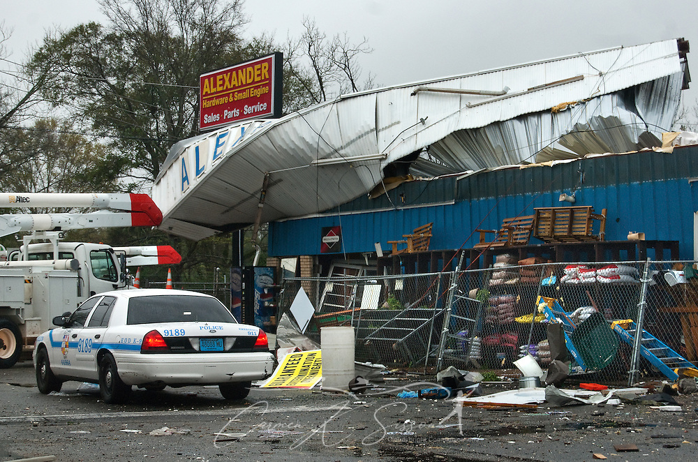 Mobile Police and Alabama Power responds to Alexander Hardware in Theodore, Ala. following a tornado March 9, 2011. Several structures were heavily damaged when a tornado moved through the area around 9 a.m. Wednesday morning. Three people were injured, and 17,000 residents were left without power following the storm. (Photo by Carmen K. Sisson/Cloudybright)