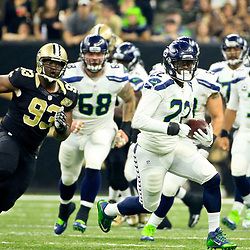 Oct 30, 2016; New Orleans, LA, USA; Seattle Seahawks running back C.J. Prosise (22) runs from New Orleans Saints defensive tackle David Onyemata (93) during the first quarter of a game at the Mercedes-Benz Superdome. Mandatory Credit: Derick E. Hingle-USA TODAY Sports