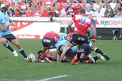 28-07-18 Emirates Airline Park, Johannesburg. Super Rugby semi-final Emirates Lions vs NSW Waratahs. 1st half. Lions left wing Aphiwe Dyantyi lays the ball back for teammate right wing Ruan Combrinck<br />  Picture: Karen Sandison/African News Agency (ANA)