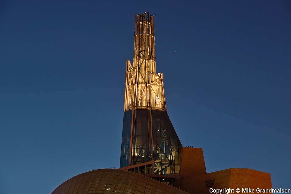 The 'Tower of Hope' of the Canadian Museum for Human Rights (CMHR) in winter at dusk<br /> Winnipeg<br /> Manitoba<br /> Canada