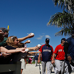 February 19, 2011; Fort Myers, FL, USA; Boston Red Sox first baseman David Ortiz (34) walks past fans following a spring training practice at the Player Development Complex.  Mandatory Credit: Derick E. Hingle