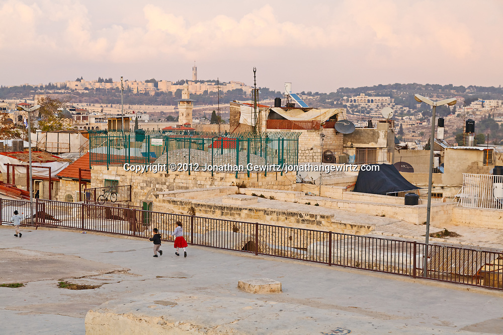 Jewish chiildren walk on rooftops in the area between the Jewish and Muslim quarters of the Old City of Jerusalem. WATERMARKS WILL NOT APPEAR ON PRINTS OR LICENSED IMAGES.