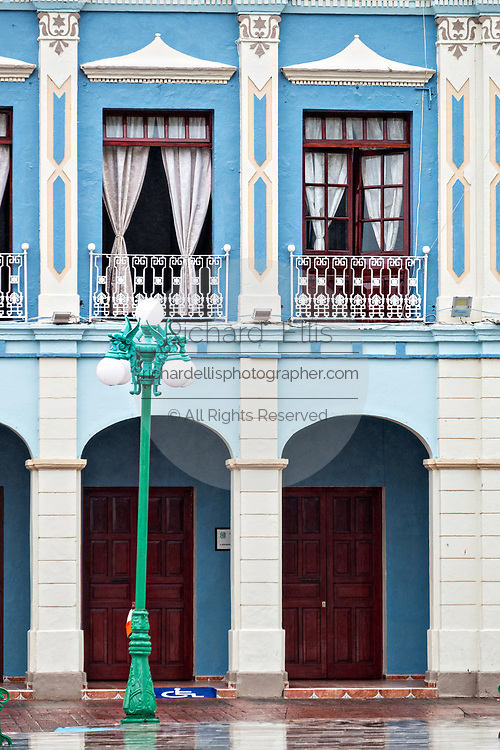 The colorful colonnade style city hall in Tlacotalpan, Veracruz, Mexico. The tiny town is painted a riot of colors and features well preserved colonial Caribbean architectural style dating from the mid-16th-century.