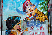 01 DECEMBER 2013 - BANGKOK, THAILAND: Anti-Shinawatra graffiti on a wall near an anti-government protest site in Bangkok. The bottom figure is Yingluck Shinawatra, Prime Minister of Thailand, the top figure is Thaksin Shinawatra, the exiled Prime Minister and brother of Yingluck. Thais complain that Yingluck is a puppet of Thaksin. He is made to look like a monitor lizard because comparing people to monitor lizards is an insult in Thailand.  Thousands of anti-government Thais confronted riot police at Phanitchayakan Intersection, where Rama I and Phitsanoluk Roads intersect, next to Government House (the office of the Prime Minister). Protestors threw rocks, cherry bombs, small explosives and Molotov cocktails at police who responded with waves of tear gas and chemical dispersal weapons. At least four people were killed at a university in suburban Bangkok when gangs of pro-government and anti-government demonstrators clashed. This is the most serious political violence in Thailand since 2010.    PHOTO BY JACK KURTZ