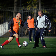 Moscow mayor Yuri Luzhkov plays football with parliamentarians in Moscow. .