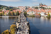 Charles Bridge seen from a tower with Prague Castle  in the back.