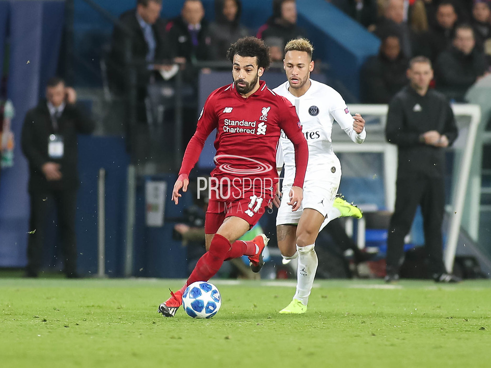 Neymar of Paris Saint-Germain and Mohamed Salah of Liverpool during the Champions League group stage match between Paris Saint-Germain and Liverpool at Parc des Princes, Paris, France on 28 November 2018.