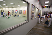 Participants wait for one class to start as another ends at Master Kim's Tae Kwon Do in Penfield on Thursday, August 20, 2015.