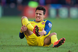 LONDON, ENGLAND - Saturday, February 21, 2015: Arsenal's Alexis Sanchez goes down with an injury to his right foot during the Premier League match against Crystal Palace at Selhurst Park. (Pic by David Rawcliffe/Propaganda)