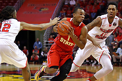 26 November 2016:  Quentin Ruff works his way between Tony Wills(12) and Phil Fayne(10) to get to the lane during an NCAA  mens basketball game between the Ferris State Bulldogs the Illinois State Redbirds in a non-conference game at Redbird Arena, Normal IL