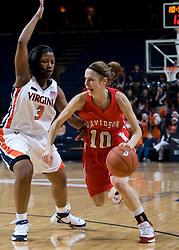 Davidson guard Alexandra Thompson (10) dribbles around Virginia guard Paulisha Kellum (3).  The Virginia Cavaliers women's basketball team defeated the Davidson Wildcats 83-68 at the John Paul Jones Arena in Charlottesville, VA on December 20, 2007.