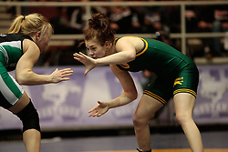 London, Ontario ---2013-03-02---    Jasmine Slinn of  University Of Regina takes on  Natasha Kramble  of  U Of Sask in the women's 48 KG bronze medal match at the 2012 CIS Wrestling Championships in London, Ontario, March 02, 2013. .GEOFF ROBINS/Mundo Sport Images