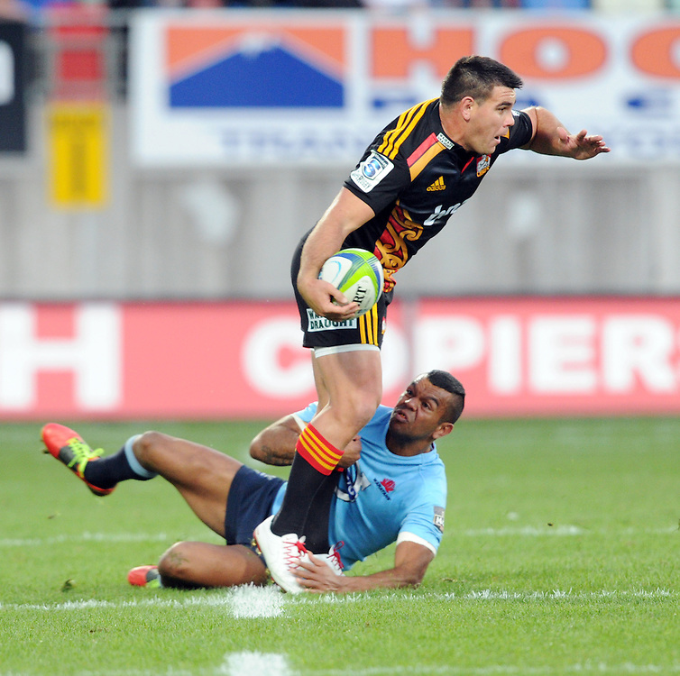 Chiefs' Dwayne Sweeney is tackled by Waratahs' Kurtley Beale in the Super Rugby match at Yarrows Stadium, New Plymouth, New Zealand, Saturday, May 31, 2014. Credit:SNPA / Ross Setford
