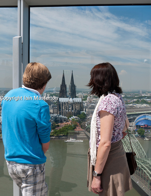 Tourists looking at view of skyline of Cologne in Germany