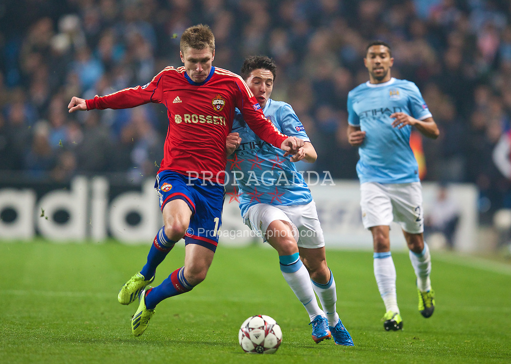 MANCHESTER, ENGLAND - Tuesday, November 5, 2013: Manchester City's Samir Nasri in action against CSKA Moscow's Kirill Nababkin during the UEFA Champions League Group D match at the City of Manchester Stadium. (Pic by David Rawcliffe/Propaganda)