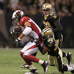 16 January 2010:  New Orleans Saints cornerback Jabari Greer (32) and linebacker Scott Shanle (58) pursues Arizona Cardinals wide receiver Larry Fitzgerald (11) during a 45-14 win by the New Orleans Saints over the Arizona Cardinals in a 2010 NFC Divisional Playoff game at the Louisiana Superdome in New Orleans, Louisiana.