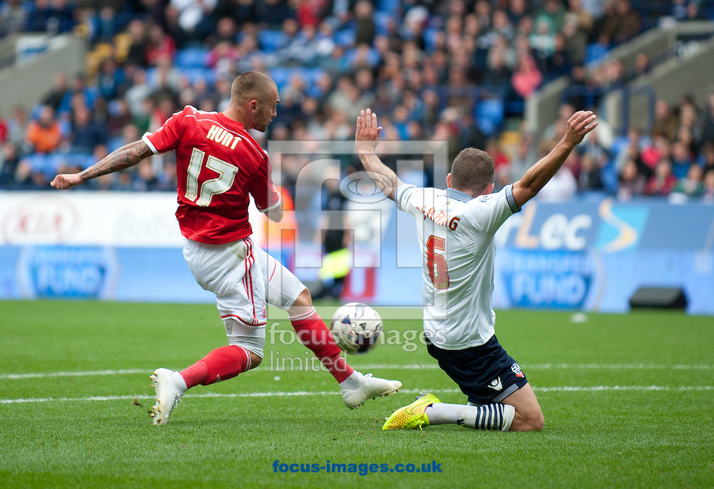 Jay Spearing of Bolton Wanderers blocks a shot by Jack Hunt of Nottingham Forest during the Sky Bet Championship match at the Macron Stadium, Bolton<br /> Picture by Russell Hart/Focus Images Ltd 07791 688 420<br /> 16/08/2014