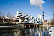 Donaukanal (Danube Channel). R: Fernwa?rme Wien garbage burning and heat generating plant, designed by Friedensreich Hundertwasser. L: Building over the old Stadtbahn tracks by Zaha Hadid.