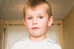 Close up of young Polish boy looking surprised,