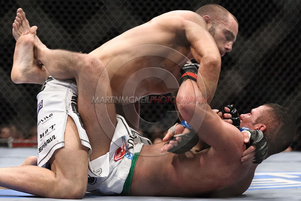 "LONDON, ENGLAND, JUNE 7, 2008: Mike Swick (top) keeps the pressure on a grounded Marcus Davis during ""UFC 85: Bedlam"" inside the O2 Arena in Greenwich, London on June 7, 2008."