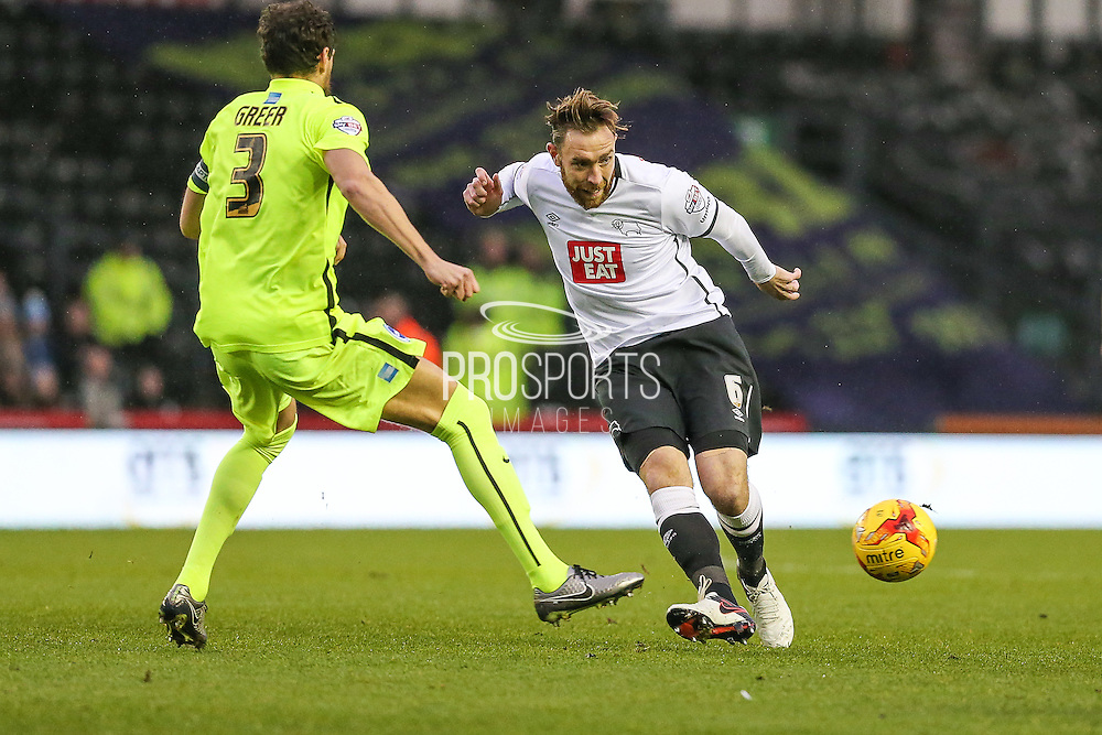 Derby County's Richard Keogh makes a pass during the Sky Bet Championship match between Derby County and Brighton and Hove Albion at the iPro Stadium, Derby, England on 12 December 2015. Photo by Shane Healey.