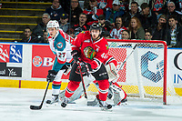 KELOWNA, CANADA - APRIL 7: Keoni Texeira #44 of the Portland Winterhawks checks Calvin Thurkauf #27 of the Kelowna Rockets as he looks for the pass in front of the net on April 7, 2017 at Prospera Place in Kelowna, British Columbia, Canada.  (Photo by Marissa Baecker/Shoot the Breeze)  *** Local Caption ***