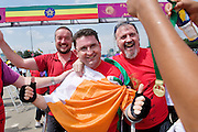 Amputee Eamonn  Victory from Dunleer Co. Louth finishes the 2012 Great Ethiopian Run (the Biggest road race in Africa with over 36,000 participants is congratulated by Self Help Africa's  Ronan Scully and Ray Jordan (left).Many charities benefit from the race while 15 irish people raised thousands of Euro for Self Help Africa to continue development programmes in Africa. Photo:Andrew Downes.