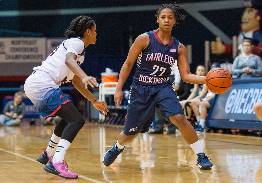 March 6 2016: Fairleigh Dickinson Lady Knights guard Kiana Brown (22) makes a pass around Robert Morris Colonials guard Janee Brown (11) during the first half in the NCAA Women's Basketball game between the Fairleigh Dickinson Lady Knights and the Robert Morris Colonials at the Charles L. Sewall Center in Moon Township, Pennsylvania (Photo by Justin Berl)