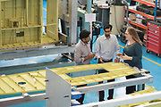 From Left to Right : Anand Babu Pallipattu,Lauren Agte and Anil Sankar inspect a part on the Chinook Ramp Assembly at Dynamatic Technologies Limited  on Wednesday, April,13th, 2016 in Bangalore. (Mahesh Bhat/AP Images for Boeing Company Frontiers Magazine)