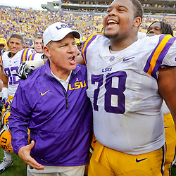 Oct 12, 2013; Baton Rouge, LA, USA; LSU Tigers head coach Les Miles with offensive tackle Vadal Alexander (78) following win over the Florida Gators at Tiger Stadium. LSU defeated Florida 17-6. Mandatory Credit: Derick E. Hingle-USA TODAY Sports