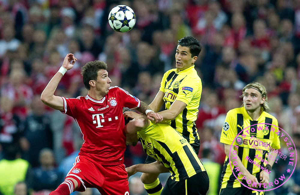 (L) Mario Mandzukic of Monachium fights for the ball with (R) Nuri Sahin of Dortmund during the UEFA Champions League Final football match between Borussia Dortmund and Bayern Munich at Wembley Stadium in London on May 25, 2013...England, London, May 25, 2013..Picture also available in RAW (NEF) or TIFF format on special request...For editorial use only. Any commercial or promotional use requires permission...Photo by © Adam Nurkiewicz / Mediasport