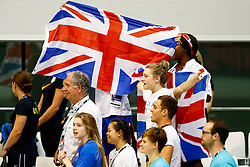 Tom Daley and Alicia Blagg of Great Britain cheer on from the sides as Sarah Barrow (not pictured) collects a Gold medal having won the Womens 10m Platform Final - Photo mandatory by-line: Rogan Thomson/JMP - 07966 386802 - 22/08/2014 - SPORT - DIVING - Berlin, Germany - SSE im Europa-Sportpark - 32nd LEN European Swimming Championships 2014 - Day 10.