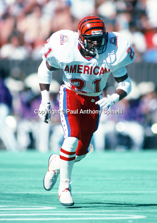 Cincinnati Bengals cornerback James Brooks (21) chases the action during the 1990 NFL Pro Bowl between the National Football Conference and the American Football Conference on Feb. 4, 1990 in Honolulu. The NFC won the game 27-21. (©Paul Anthony Spinelli)