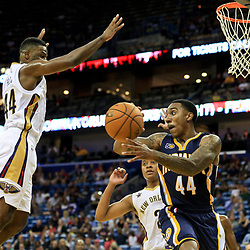 Oct 4, 2016; New Orleans, LA, USA;  Indiana Pacers guard Jeff Teague (44) is defended by New Orleans Pelicans guard Tim Frazier (2) and forward Solomon Hill (44) during the second quarter of a game at the Smoothie King Center. Mandatory Credit: Derick E. Hingle-USA TODAY Sports