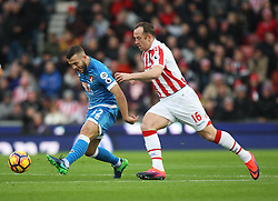 Jack Wilshere of Bournemouth (L) and Charlie Adam of Stoke City in action - Mandatory by-line: Jack Phillips/JMP - 19/11/2016 - FOOTBALL - Bet365 Stadium - Stoke-on-Trent, England - Stoke City v Bournemouth - Premier League