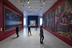 """© Licensed to London News Pictures. 14/05/2018. LONDON, UK. Gallery staff are seen in the new Collection Gallery viewing, (L to R) Leonardo Da Vinci 's """"The Last Supper"""", copy made 1515-20, """"The Virgin and Child with the infant St. John"""", 1504-05, by Michelangelo, and copies of Raphael's paintings, 1483-1520, made by Sir James Thornill, at a photocall for the opening of the new Royal Academy of Arts (RA) in Piccadilly.  As part of the celebrations for its 250th anniversary year, redevelopment has seen the RA's two buildings, 6 Burlington Gardens and Burlington House, united into one extended campus and art space extending from Piccadilly to Mayfair.  Photo credit: Stephen Chung/LNP"""