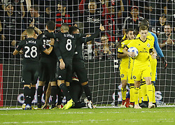 November 1, 2018 - Washington, DC, USA - D.C. United players celebrate a goal by defender Frederic Brillant (13) as Columbus Crew SC midfielder Wil Trapp (6) brings the ball back to midfield during the first half of the MLS Cup knockout round playoff match at Audi Field in Washington, D.C., on Thursday, Nov. 1, 2018. (Credit Image: © Adam Cairns/Columbus Dispatch/TNS via ZUMA Wire)