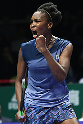 SINGAPORE, Oct. 24, 2017  Venus Williams of United States reacts after winning the group match against Jelena Ostapenko of Latvia at WTA Finals tennis tournament in Singapore, Oct. 24, 2017. (Credit Image: © Then Chih Wey/Xinhua via ZUMA Wire)