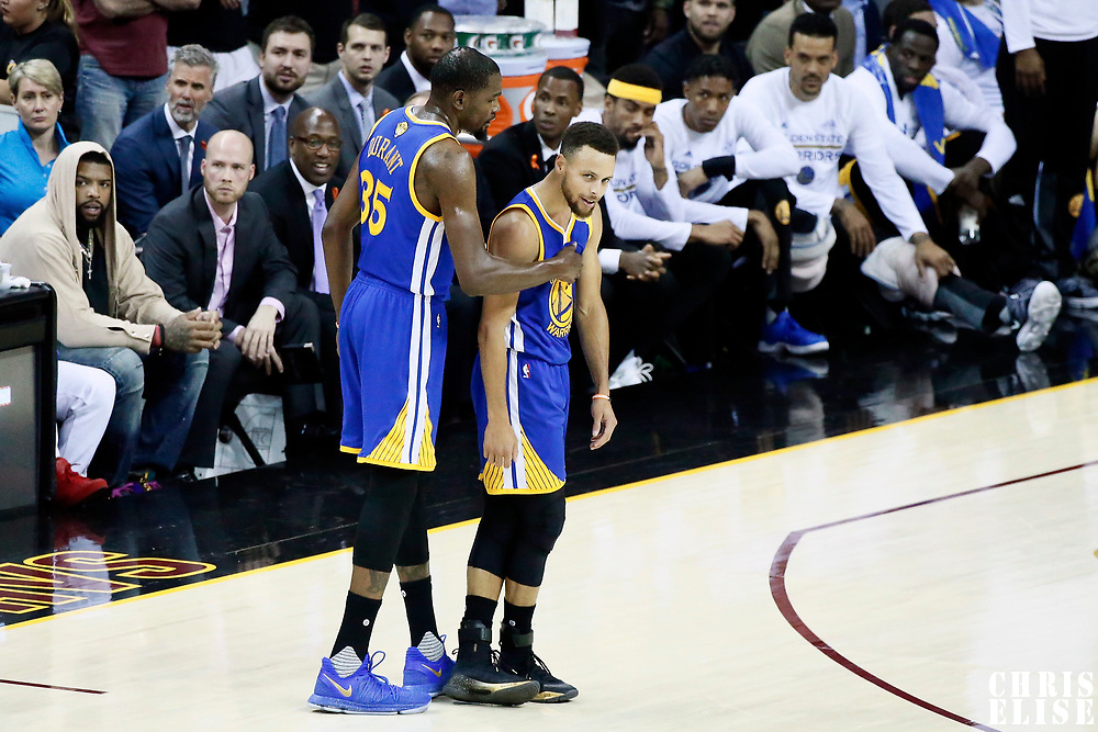 09 June 2017: Golden State Warriors forward Kevin Durant (35) is seen with Golden State Warriors guard Stephen Curry (30) during the Cleveland Cavaliers 137-11 victory over the Golden State Warriors, in game 4 of the 2017 NBA Finals, at  the Quicken Loans Arena, Cleveland, Ohio, USA.