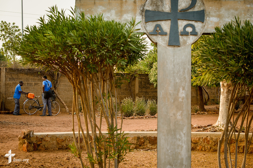 Before leaving home, students fill water jugs from an onsite well at the Lutheran Center for Theological Studies (CLET) on Wednesday, Feb. 15, 2017, in Dapaong, Togo. The center allows students use of the water for their nearby homes. LCMS Communications/Erik M. Lunsford