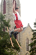 Goshen, NY - A member of the Skyriders, an acrobatic trampoline team, jumps high into the air while wearing skis at the Great American Weekend festival on July 5, 2008.